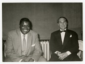 view [Oscar Peterson and Norman Granz, undated] [black and white photoprint] digital asset: [Oscar Peterson and Norman Granz, undated] [black and white photoprint].