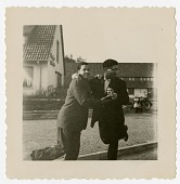 view [Dizzy Gillespie dancing with a man in outdoor setting, undated photo.] [Black-and-white photoprint] digital asset: [Dizzy Gillespie dancing with a man in outdoor setting, undated photo.] [Black-and-white photoprint].