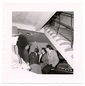 view [Flip Phillips (second from left), Norman Granz (second from right), and other men,talking under staircase, undated.] [Black-and- white photoprint] digital asset: [Flip Phillips (second from left), Norman Granz (second from right), and other men,talking under staircase, undated.] [Black-and- white photoprint].