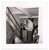 view [Norman Granz talking to another man near staircase, undated.] [Black-and-white photoprint] digital asset: [Norman Granz talking to another man near staircase, undated.] [Black-and-white photoprint].