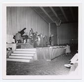 view [Dizzy Gillespie (trumpet), Oscar Peterson (piano) Herb Ellis (guitar), Ray Brown (bass), and a few other musicians in concert, undated.] [Black-and-white photoprint] digital asset: [Dizzy Gillespie (trumpet), Oscar Peterson (piano) Herb Ellis (guitar), Ray Brown (bass), and a few other musicians in concert, undated.] [Black-and-white photoprint].