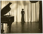 view Luther Davis Papers digital asset: [Ava Gardner, piano in foreground]. [black-and-white photoprint].