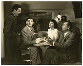 view [Man standing, Clark Gable, Ava Gardner, Edward Arnold]. [black-and-white photoprint] digital asset: [Man standing, Clark Gable, Ava Gardner, Edward Arnold]. [black-and-white photoprint].