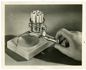 view [Ash tray with cigarettes, cigarette holder, cigarette lighter, and hand : black-and-white photoprint,] digital asset: [Ash tray with cigarettes, cigarette holder, cigarette lighter, and hand : black-and-white photoprint,], 1951.