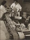 view [Women packing cases of 24-ounce salt packages, silver gelatin photoprint.] digital asset: [Women packing cases of 24-ounce salt packages, undated : silver gelatin photoprint.]