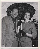 view Maid of Cotton, Beverly Louise Pack, 1954, with John Wayne. [black and white photoprint] digital asset: Maid of Cotton, Beverly Louise Pack, 1954, with John Wayne. [black and white photoprint].