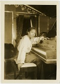 view [International Sweethearts of Rhythm, pianist.] [Black-and-white photoprint] digital asset: [International Sweethearts of Rhythm, pianist.] [Black-and-white photoprint].