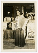 view [Member of International Sweethearts of Rhythm playing accordion.] [Black-and-white photoprint] digital asset: [Member of International Sweethearts of Rhythm playing accordion.] [Black-and-white photoprint].