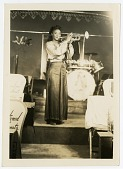 view [Sadie D. Whitehead, member of the Sweethearts of Rhythm-Piney Woods Band, trumpeter.] [Black-and-white photoprint] digital asset: [Sadie D. Whitehead, member of the Sweethearts of Rhythm-Piney Woods Band, trumpeter.] [Black-and-white photoprint].