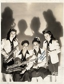 "view [Four members of International Sweethearts of Rhythm, one of whom is Rosalind ""Roz"" Cron]. [Black-and-white photoprint] digital asset: [Four members of International Sweethearts of Rhythm, one of whom is Rosalind ""Roz"" Cron]. [Black-and-white photoprint]."