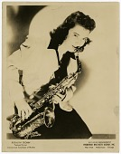"view Rosalind ""Roz"" Cron [playing saxophone] [black-and-white photoprint] digital asset: Rosalind ""Roz"" Cron [playing saxophone] [black-and-white photoprint]."