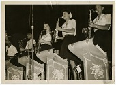 """view [Four women in the saxophone section of the """"Sweethearts"""" performing, undated.] [black-and-white photoprint] digital asset: [Four women in the saxophone section of the """"Sweethearts"""" performing, undated.] [black-and-white photoprint]."""