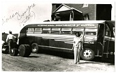 "view [The ""Sweethearts""' tutor, Vivian Crawford, standing in front of the group's bus]. [black-and-white photoprint] digital asset: [The ""Sweethearts""' tutor, Vivian Crawford, standing in front of the group's bus]. [black-and-white photoprint]."