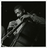 "view Ron Carter at Sam Rivers's May 21, 1965 session for ""Contours"" (Blue Note) at the Van Gelder studio, New Jersey [black-and-white photoprint] digital asset: Ron Carter at Sam Rivers's May 21, 1965 session for ""Contours"" (Blue Note) at the Van Gelder studio, New Jersey [black-and-white photoprint]."