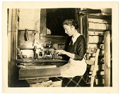 view [Woman typing in Sandford Greeting Card Company office, photoprint] digital asset number 1
