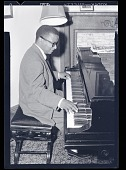 view [Billy Strayhorn playing piano in a home,] May 26th, 1952 [cellulose acetate photonegative] digital asset: Duncan Schiedt Jazz Collection