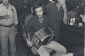 view Accordian Player, Louisiana digital asset: The first accordion was built by a German in 1822.  It took another hundred years before it was introduced into country music.