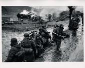 view U.S. Marines pass a burning Korean village in the winter rain digital asset: US Marines pass burning Korean village
