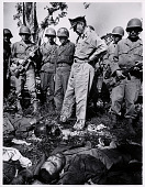 view MacArthur visits the battlefield on Bataan, in the Philippines digital asset: General Douglas MacArthur on the battlefield at Bataan
