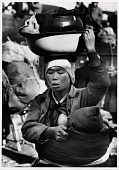 view A Korean mother flees the fighting around Seoul digital asset: A Korean mother carrying her baby and worldly goods flees Seoul