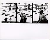 view People Walking Along Boardwalk digital asset: Three frames of people walking, photograph by Ray K. Metzker