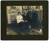 view Man and child in parlor digital asset number 1