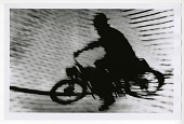 view Motorcycle Stunt digital asset: Photograph by Heini Mayer, Motorcycle Stunt, Black Star Publishing Company
