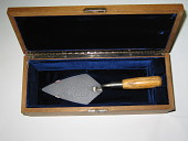 view Ceremonial trowel - one of three fabricated for use by President Eisenhower and dignitaries in dedication of U.S. Atomic Energy Commission's headquarters building, Germantown, MD on November 8, 1957 digital asset: Ceremonial trowel in wooden box