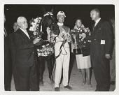 view Horse racing digital asset: Photograph by Ken Regan, race winner with trophy
