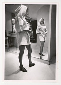 view Fashion digital asset: Photograph by Ken Regan, woman in short habit