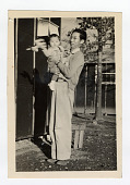 view photo in camp digital asset: Photograph, man and child, Arkansas, 1940s