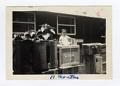 view baby photo digital asset: Photograph, child sitting atop a pile of crates packed to go to Heart Mountain, Jerome Relocation Center, 1940s