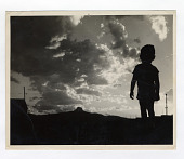 view camp photo digital asset: Photograph, child watching sunset, Heart Mountain Relocation Center, 1940s