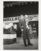 view George Wallace digital asset: Photograph by Ken Regan, George Wallace holding a child
