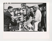 view George Wallace digital asset: Photograph by Ken Regan, George Wallace with deli meat slicer