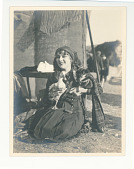 view Mary Pickford with a dog and duck digital asset: Photograph by F.B. Lichtman, Mary Pickford with a dog and duck, ca 1916