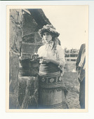 view Mary Pickford with a bucket digital asset: Photograph by F.B. Lichtman, Mary Pickford with a bucket, ca 1916