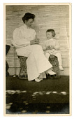 view Woman and young child on wicker stools digital asset number 1