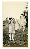 view Young child at clothesline digital asset number 1