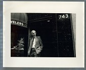 view Man leaning in jewelers' doorway digital asset: Photograph by Roy Zalesky
