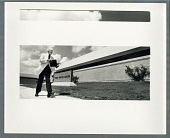 view Man walking in front of a Public Health Center digital asset: Photograph by Roy Zalesky