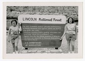 """view two girls next to """"Lincoln National Forest"""" sign digital asset: two girls next to 'Lincoln National Forest' sign"""