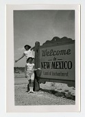 """view two girls next to """"Welcome to New Mexico"""" sign digital asset: two girls next to 'Welcome to New Mexico' sign"""
