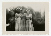 view three women standing arm in arm digital asset: Three women standing arm in arm