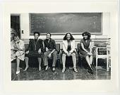 view Five women sitting in front of blackboard digital asset: Five women sitting in front of blackboard