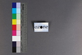 """view ozone digital asset: Rectangular pinback button with black letters spelling """"ozone"""" on a background of blue sky with light cloud cover. The middle """"O"""" in ozone is cut out."""