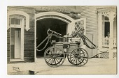 """view empty carriage in front of garage with sign """"Sarah Zane""""; fire pump digital asset number 1"""