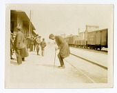 view African-American Man Dancing at Railroad Station digital asset: African-American Man Dancing at Railroad Station