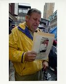 view Missing: Melissa Vincent digital asset: #46 Man holding missing woman's flyer