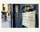 view #54 Acapella Restaurant with sign on door digital asset: #54 Acapella Restaurant with sign on door